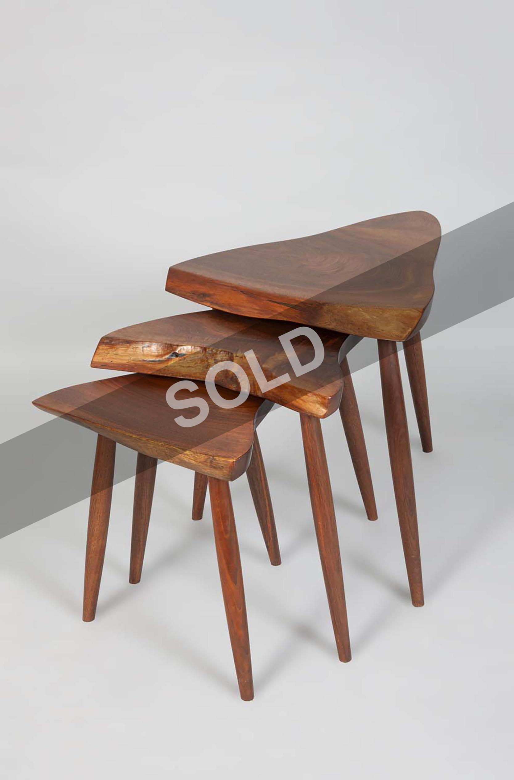 George Nakashima nest of walnut tables.jpg